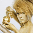 Golden girl with apple — Stock Photo