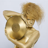 Golden girl with vinyl — Stock Photo