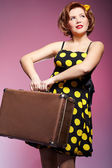 Pin-up girl with luggage — Stock Photo