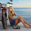 Blonde and red motorcycle - Stock Photo