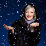 Woman under snow — Stock Photo