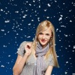 Happy girl in snowflakes - Stock Photo