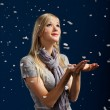Happy girl in snowflakes — Stockfoto