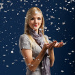 Happy girl in snowflakes — Stock Photo
