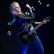 Blonde girl with guitar — Stock Photo