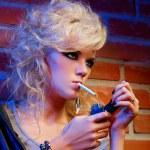 Beautiful blonde girl smoking — Stock Photo
