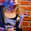 Beautiful blonde girl smoking — Stock Photo #4256729