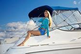 Blonde posing on yacht — Stock Photo