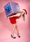 Xmas girl with gift — Stock Photo