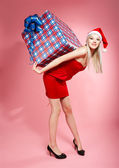 Xmas girl with gift — Stock Photo