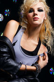 Beautiful blonde girl rocker — Stock Photo