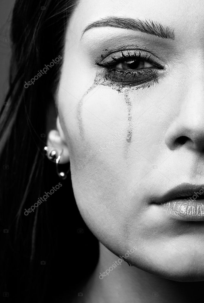 Close-up portrait of beautiful crying girl with smeared mascara — Stock Photo #4253446