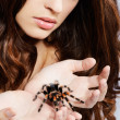 Girl with spider — Stock Photo