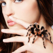 Girl with spider — Stock Photo #4286748