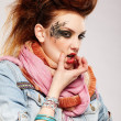 Wriggling glam punk girl — Stock Photo