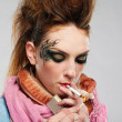 Glam punk girl smoking - Stock Photo