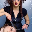 Spider girl and victim — Stock Photo