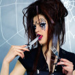 Stock Photo: Spider girl licking knife