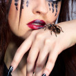 Spider-girl and Brachypelma smithi — Stock Photo #4325377