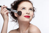 Girl making up — Stock Photo