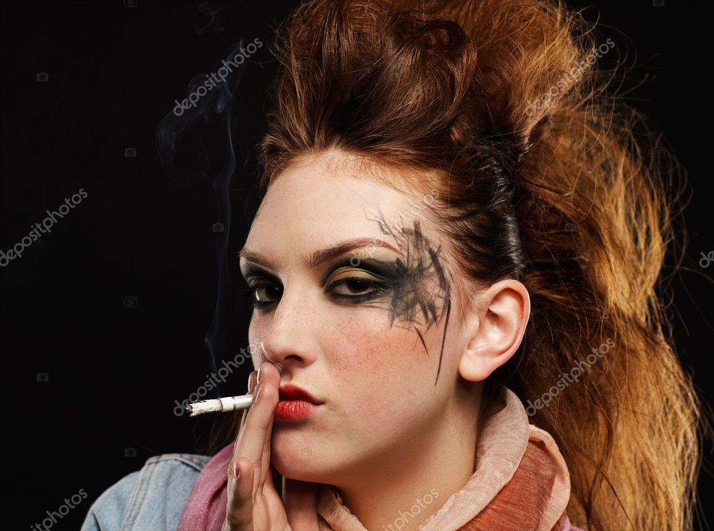 Portrait of glam punk redhead girl smoking cigarette — Stock Photo #4325183