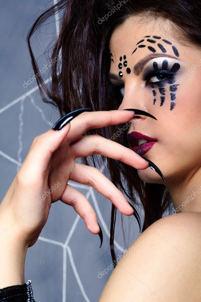Portrait of girl with spider bodyart of face zone looking over her shoulder — Stock Photo #4325366