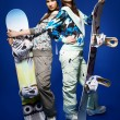 Two girls with snowboards — Stock Photo