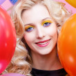 Blonde girl with balloons — Stock Photo