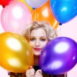 Blonde girl with balloons — 图库照片