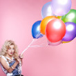 Blonde girl with balloons — Stock Photo #4583953