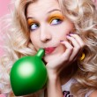 Blonde girl with balloon — Stock Photo
