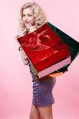 Flicka med kassar och påsar — Stockfoto