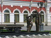 Sculptures near railroad station — Stock Photo