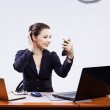 Businesswoman with two laptops — Stock Photo #4715138