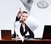 Businesswoman with two laptops — Stock Photo