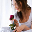 Beautiful girl with rose — Stock Photo