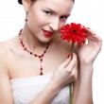Girl with gerbera flower — Stock Photo