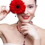 Girl with gerbera flower — Stock Photo #4923165