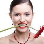 Girl with gerbera flower — Stock Photo #4923175