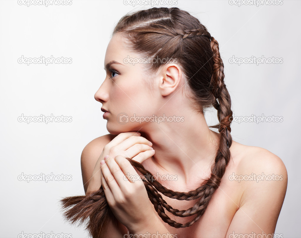 Hairstyle portrait of beautiful brunette girl with creative braid hairdo — Stock Photo #5035278