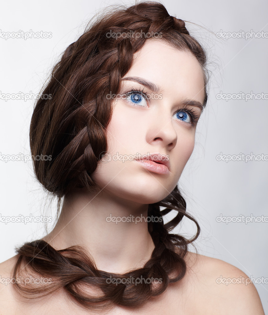 Hairstyle portrait of beautiful brunette girl with creative braid hairdo — Stock Photo #5035345