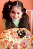 Pretty girl propose pizza — Stock Photo