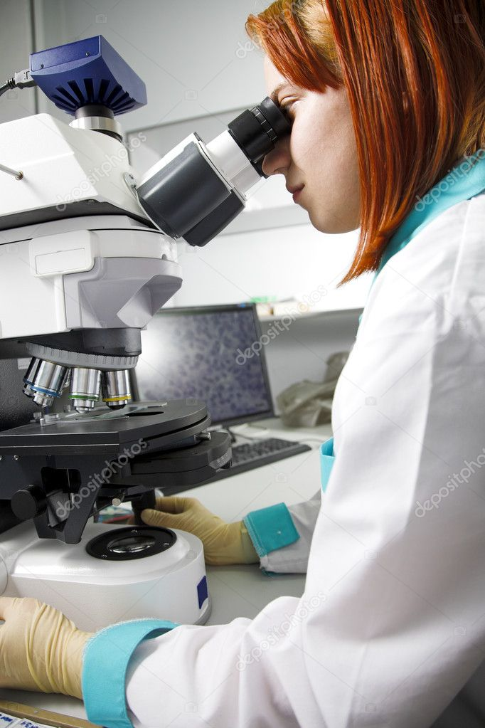 Young woman with microscope in research center — Stock Photo #2947013