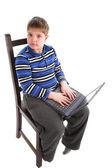 Chlapec s notebookem — Stock fotografie