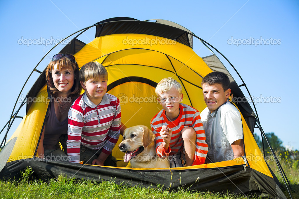 Happy family in the tent on sunny meadow — Stock Photo #3047284
