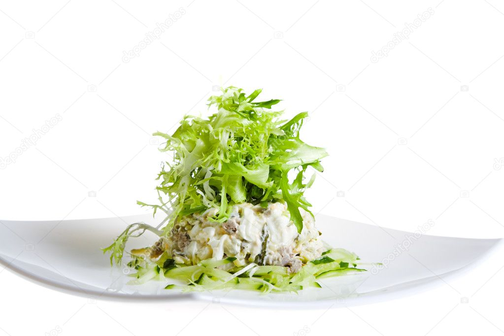 Fresh salad with rucola on white plate — Stock Photo #3661426