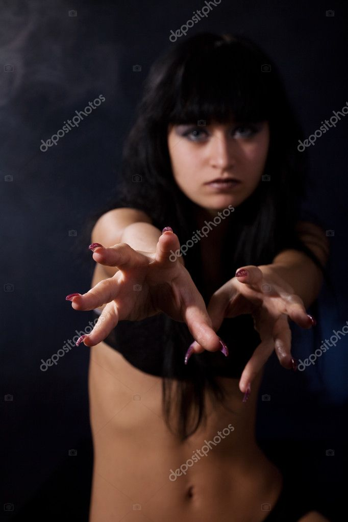Aggressive girl isolated on the black background — Stock Photo #3792940