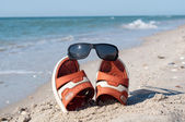 Flip-flops with sunglasses — Stock Photo