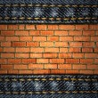 Jeans and brick background - Stock Photo