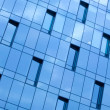 Blue glass wall office building — Stock Photo